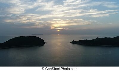 aerial view, descent in of calm, evening sea - aerial drone...