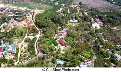 aerial view distant Buddha statue among landscape - high...