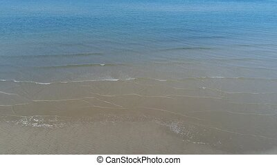 aerial view, dolly in of calm, sea shallow sandy