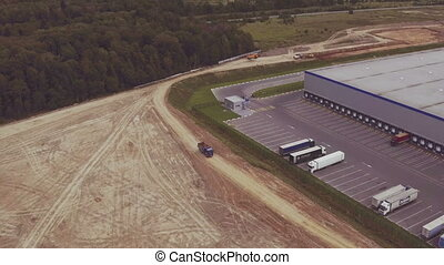 Aerial view driving dump truck - aerial view on building...