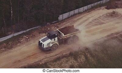 Aerial view driving dump truck