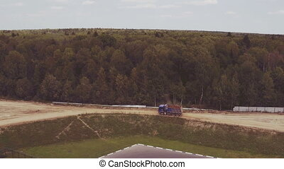 Aerial view driving dump truck in nature
