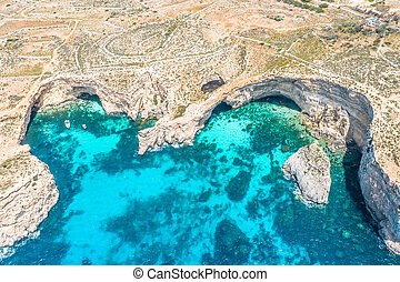 Aerial view drone - blue lagoon among the rocks sea.