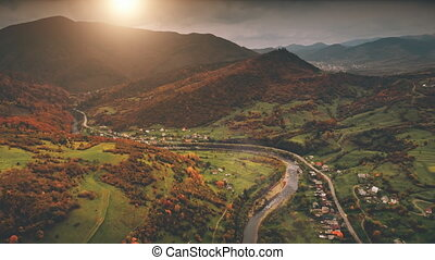 Flight over dramatic autumn mountain landscape