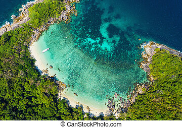 Aerial view drone shot ocean waves, Beautiful tropical beach and rocky coastline and beautiful forest. Nga Khin Nyo Gyee Island Myanmar. Tropical seas and islands in southern Myanmar