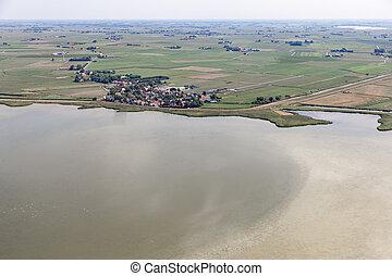 Aerial view Dutch village Gaast at lake IJsselmeer with shallow water