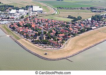 Aerial view Dutch village Hindeloopen at lake IJsselmeer with marina