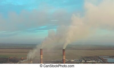Aerial view. Emission to atmosphere from industrial pipes....