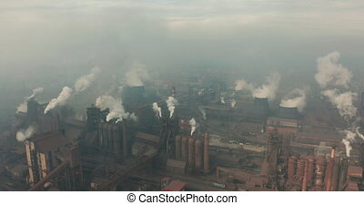 Aerial view. Emission to atmosphere from industrial pipes. Smokestack pipes shooted with drone