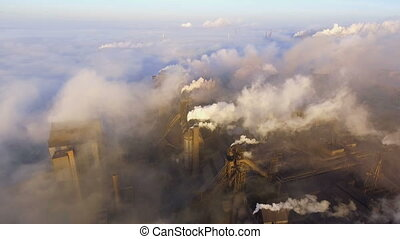 Aerial view. Emission to atmosphere from industrial pipes. Smokestack pipes shooted with drone.