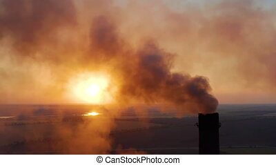 Aerial view. Emission to atmosphere from industrial pipes. Smoking chimney