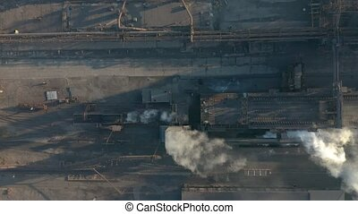 Aerial view. Emission to atmosphere from industrial pipes