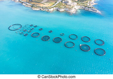 Aerial view, fish farm with floating cages in the Mediterranean sea.