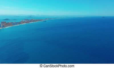Aerial view. Flight over gorgeous islands, long spit...