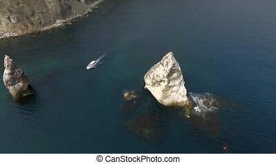Aerial View: Flight over the Coast. Fiolent cape, near Balaklava, Crimea. Cape Fiolent occupies a special place among Crimean beauties. Slow motion