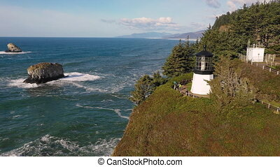 Aerial View Flying Beside Cape Meares Lighthouse Pacific...