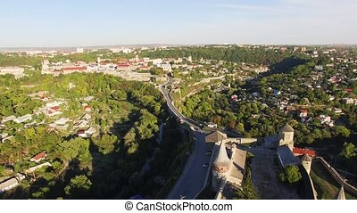 Aerial view Flying camera over of the old castle. Ukrine. aLviv. Pidgirtsi. Travel tourism adventure in wild nature camera bird eye view.