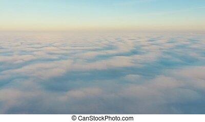 Aerial View. Flying in fog, fly in mist. Aerial camera shot....