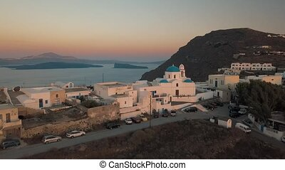 Aerial view flying over small town on Santorini Greece