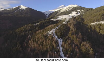 Aerial View. Flying over the beautiful mountain River and beautiful forest.