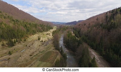 Aerial View. Flying over the beautiful mountain River and forest