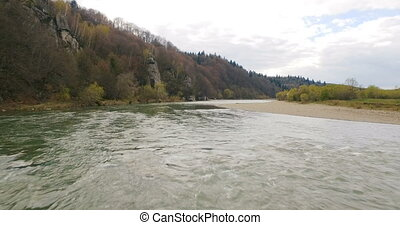 Aerial View. Flying over the beautiful River. Aerial camera shot