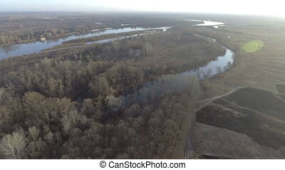 Flying over the beautiful River and Forest. Aerial camera shot.