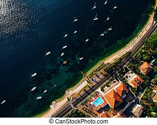 Aerial view from above to the marina with yachts on a sunny day in Italy