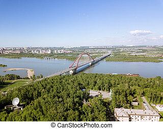 Aerial view from afar of Bugrinsky bridge in Novosibirsk.