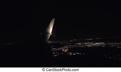 Aerial view from airplane window over night city lights