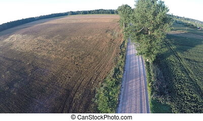 Aerial view from drone over beautiful farmland gravel road...