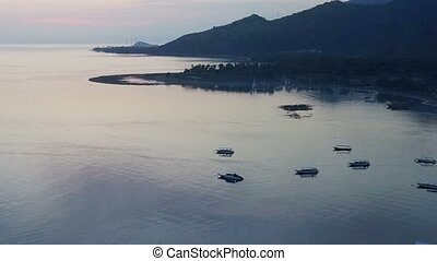 Aerial view from drone,Stony seacoast and mountains on a sunset. Indonesia. Bali.