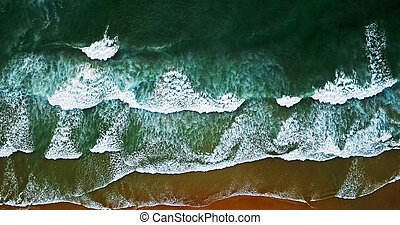Aerial View From Flying Drone Of Ocean Waves Crushing On Beach