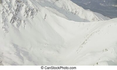 Aerial view from helicopter flying over the mountains of...
