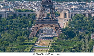 Aerial view from Montparnasse tower with Eiffel tower and Champ de Mars timelapse in Paris, France.