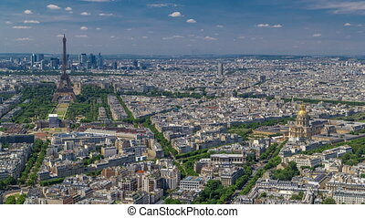 Aerial view from Montparnasse tower with Eiffel tower and La Defense district on background timelapse in Paris, France.