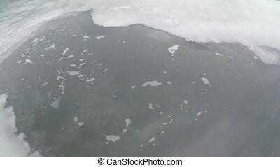 2.7K Movement on an ice floe - Aerial view from Quadcopter...