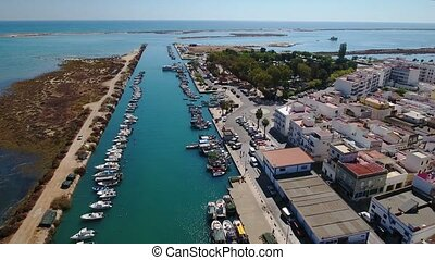Aerial. View from sky of village of Fuseta on Ria Formosa.
