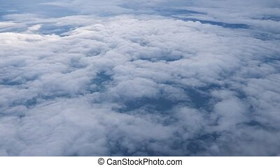 Flying over the layer of clouds and looking on landscape...