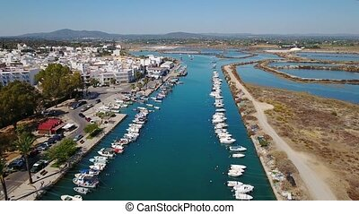 Aerial. View from the sky boats moored to pier. Fuseta Tavira