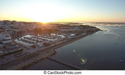 Aerial. View from the sky, sunrise, over the tourist city of Faro.