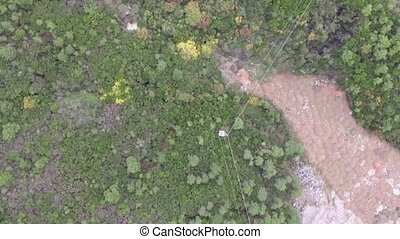 Aerial View - Green And Yellow Treetops Near The Mouth Of...
