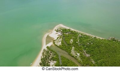 Aerial view green island and sea. Beautiful view from flying drone over tropical island and sandy sea shore. Landscape from above.