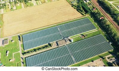 Aerial View Greenhouses For Growing Flowers, Vegetables And Fruits. Agricultural And Industrial Buildings. 4K