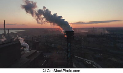 Aerial view. High chimney pipe with grey smoke. concept of environmental pollution, climate change.