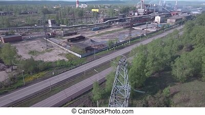 Aerial view. High voltage tower and industrial plants. Air...