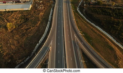Aerial view. Highway and overpass with cars and trucks. The...
