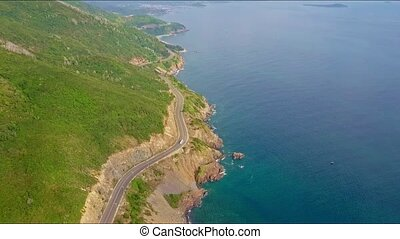Aerial View Highway with Driving Car along Rocky Slopes