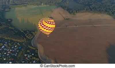 Hot air balloon in sky - Aerial view Hot air balloon in sky...