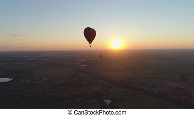 Hot air balloon shape heart in sky - Aerial view Hot air...